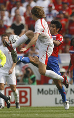 Poland's Miroslaw Szymkowiak and Costa Rica's Mauricio Solis fight for ball in Hanover