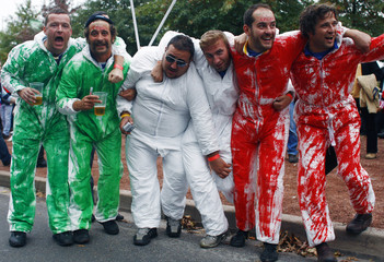 Fans of Italy pose before the Rugby World Cup match against Scotland in St Etienne