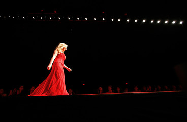 Lee Ann Womack walks the runway during the Heart Truth Red Dress fashion show in New York