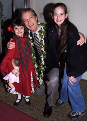 ACTOR RICHARD CHAMBELAIN POSES WITH YOUNG COSTARS.