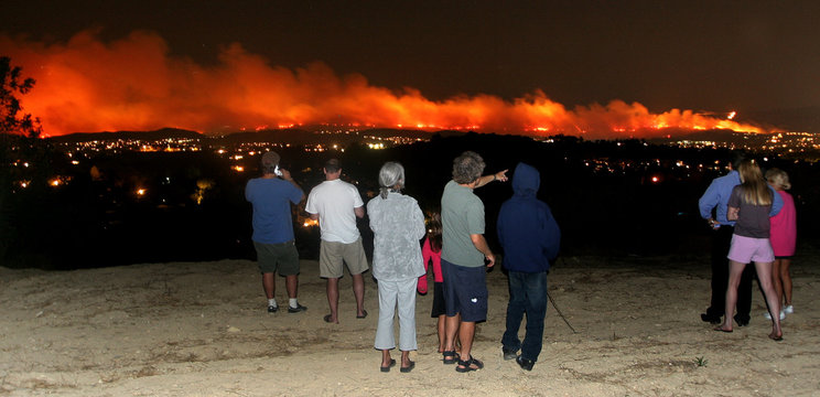 Valley residents look over city lights at the Chatsworth brush fire