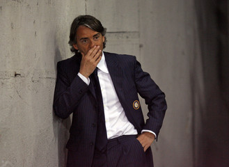 Inter Milan's Mancini watches their Italian Cup semi-final soccer match against Lazio from a tunnel after he was sent off by referee in Rome