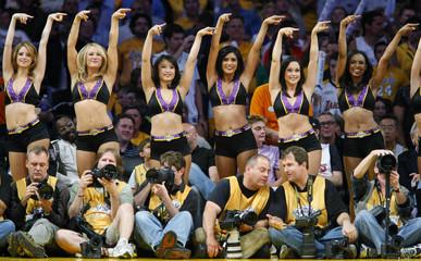 Los Angeles Laker Girls perform behind photographers on the sidelines during Game 2 of the  NBA Finals in Los Angeles