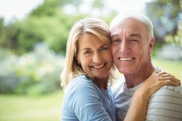 Portrait of senior couple embracing outdoors