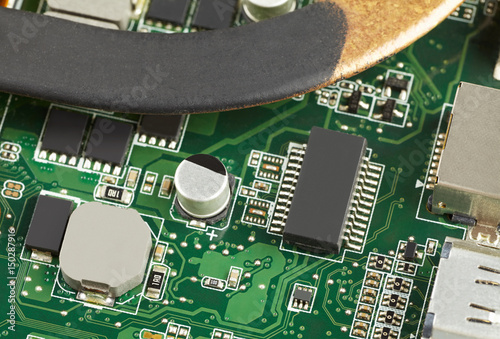 different electronic components on a green circuit board stock rh fotolia com