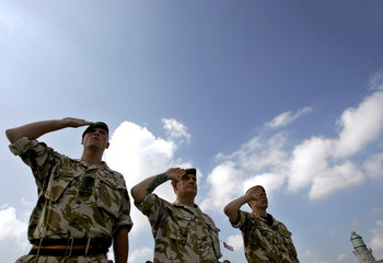 British soldiers of The King's own Royal Border Regiment salute during ceremony at fort in Havana