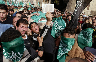PALESTINIANS CARRY THE BODY OF HAMAS ACTIVIST JIHAD RASMI DUFESH DURINGHIS FUNERAL IN THE WEST BANK ...
