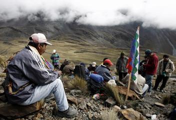 Bolivian peasants rest during protest march near La Cumbre north of La Paz
