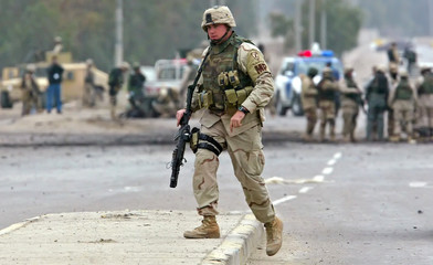 US soldier arrives to scene of car bomb in Baghdad.