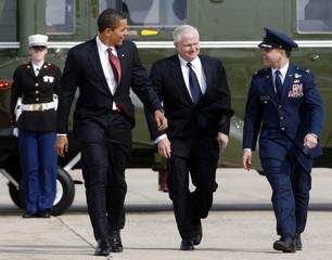 U.S. President Barack Obama and Secretary of Defense Robert Gates board Air Force One at Andrews Air Force Base, near Washington