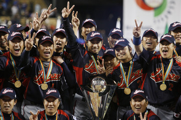 Team Japan poses with their trophy after defeating Team Korea in the World Baseball Classic championship game in Los Angeles