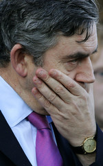 Britain's Chancellor Of The Exchequer Brown places his hand over his mouth during the opening ceremony for the 'Anne Frank and You' festival in Kirkaldy Memorial Gardens, in eastern Scotland