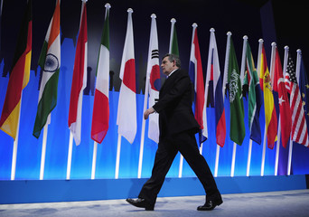 Britain's Prime Minister Gordon Brown leaves the stage after speaking at a news conference after the G20 summit at the ExCel centre in east London