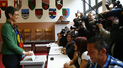 Ulrike Lunacek, Austrian Green party's top candidate, casts vote during European Parliamentary elections,  in Vienna