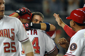 Nationals catcher Nieves celebrates with teammates after his 2-run homerun to beat Cubs in their NLB game in Washington