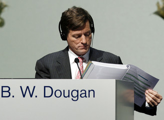 New Chief Executive of Credit Suisse Dougan studies papers during the company's annual shareholder meeting in Zurich