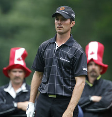 Mike Weir stands on the second tee as fans wear hats with a maple leaf design in the third round of the U.S. Open golf championship on the Black Course at Bethpage State Park in Farmingdale