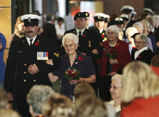 Muriel Andrews leads a procession of war brides down the isle in Halifax