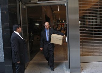 A man walks out of the Lehman Brothers building carrying a box in New York