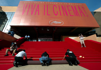 WORKMEN LAY RED CARPET AT 56TH INTERNATIONAL FILM FESTIVAL IN CANNES.