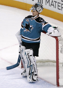Sharks goalie Evgeni Nabokov rests at his net as the NHL reviews a Stars goal in the second period during Game 5 of their NHL Western Conference semi-final hockey game