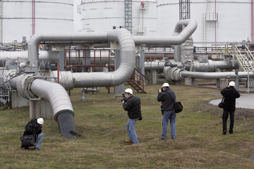 Photographers take pictures of PKN Orlen's oil refinery Mazeikiu Nafta in Mazeikai