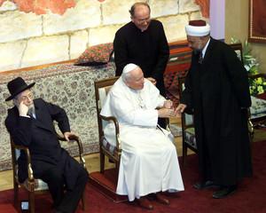 SHEIIKH AL-TAMIMI LEAVES INTER-RELIGIOUS GATHERING WITH POPE JOHN PAUL II AND CHIEF RABBI LAU.