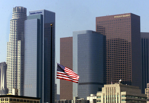An American flag flies at half-staff with the skyline of downtown Los Angeles in the background Sept..