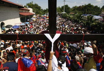 Penitent is nailed to wooden cross to mark death of Jesus Christ on Good Friday in Kapitangan village