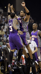 Phoenix Suns Jackson and Richardson celebrate midcourt against Grizzlies in Memphis.