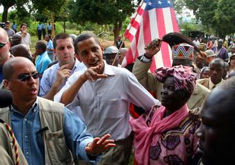 US Senator Obama holds his step grandmother Sarah as he returned to his ancestral rural village in Kenya