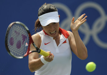 Zheng Jie of China returns to Nuria Llagostera Vives of Spain during a women's singles second round tennis match at the Beijing 2008 Olympic Games