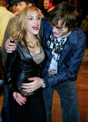 """Actress Brittany Murphy (L), currently starring in the movie """"8 Mile,"""" and actor Ashton Kutcher, fro.."""