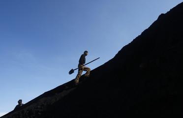 Afghan miner works at Karkar coal mine in Pul-i-Kumri