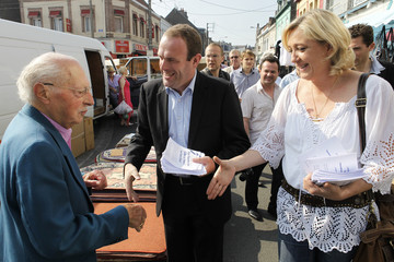Le Pen, daughter of France's far-right National Front political party leader Jean-Marie Le Pen, and Briois, head of list for municipal elections, campaign in Henin Beaumont