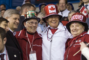 Prime Minister Harper with spectators during World Men's Curling in Moncton, New Brunswick