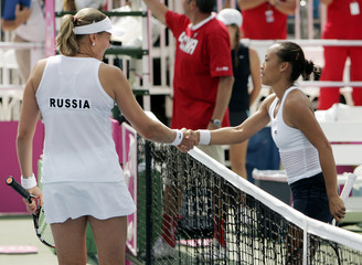 Petrova of Russia and Tu of U.S. shake hands after Petrova won their singles match in Fed Cup tennis semi-final tie in Stowe