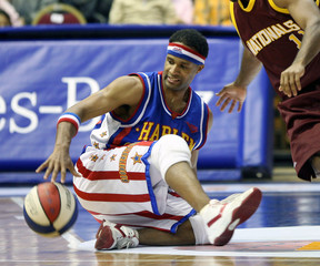 Herbert Lang of Harlem Globetrotters hides the ball during an exhibition game with opponents NY Nationals in Abdi Ipekci Arena in Istanbul