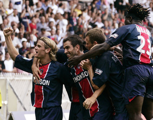 Paris St Germain's Pauleta celebrates his goal with team mates in French Ligue 1 soccer match ...