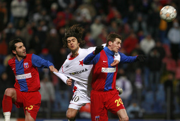 Steaua Bucharest's Neaga and Lovin fight for the ball with Slavia Prague's Gaucho during their Champions League soccer match in Bucharest