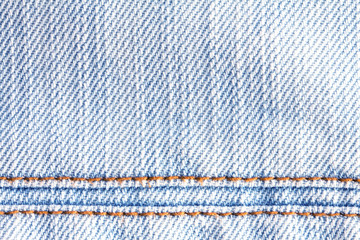 Close up the denim  blue jeans surface with seam texture background