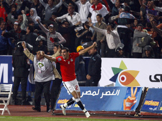 Egypt's Sherif Abdel-Fadil celebrates a goal against Algeria during their World Cup 2010 qualifying soccer match in Cairo