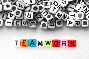 colorful alphabet  word cube of  TEAMWORK