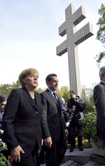 Germany's Chancellor Merkel and France's President Sarkozy arrive at the Charles De Gaulle Memorial in Colombey les Deux Eglises