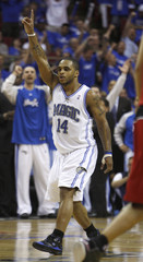 Orlando Magic Nelson celebrates after hitting a three pointer against Toronto Raptors during their NBA basketball playoff series in Orlando
