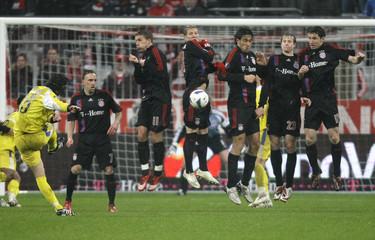 Players of Bayern Munich block a freekick of Granero of Getafe during their UEFA Cup quarter final first leg soccer match in Munich