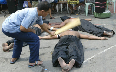A FILIPINO PENITENT WHIPPED DURING LENT OBSERVANCE IN MANILA.