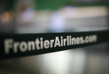 A strap guides Frontier Airlines passengers checking in at the Denver airport