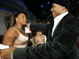 Cast member LL Cool J greets co-star Queen Latifah at the premiere of Last Holiday in Los Angeles
