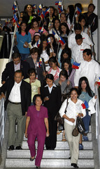 Arroyo arrives from Middle East bringing home 120 jobless overseas workers at Manila International airport